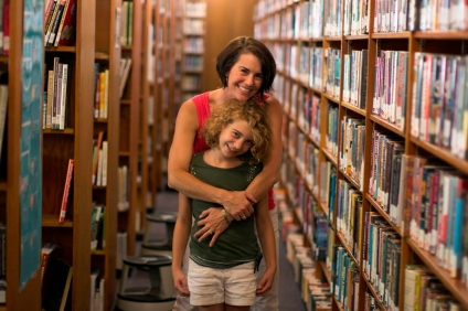 Branch Manager Roberta Lee and her daughter Sophia amid the stacks at the Illinois Valley branch.